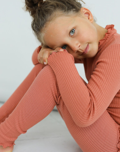 Children's merino wool long sleeve top with frilled edges